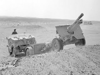Quad and 25-pounder in action in the desert